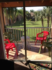Your screened lanai that overlooks the courtyard, heated pool, and workout area.