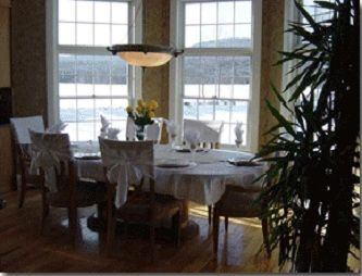 An image of the well set dining room with extraordinary views.
