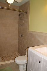 Cruz Bay condo photo - Adjacent bathroom features elegant walk-in tiled shower.