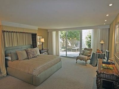 Palm Springs house rental - Bedroom #2 with king bed and attached full bath. Patio sitting area outside.