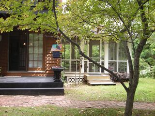 Empire house photo - Deck and screened porch, backyard