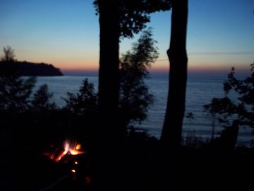 Late sunset fire pit area view. Nature and beauty surround the area.