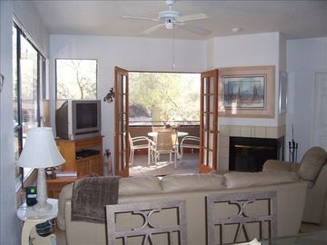 Tucson condo rental - Living room opens up to screened in porch, wood fireplace