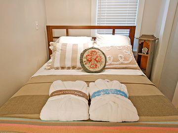 Queen bed with luxury linens + plush robes