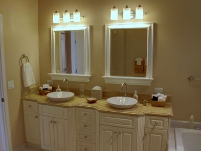 Luxurious master bath has dual sinks.