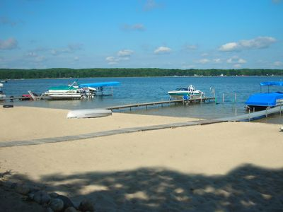 Private sandy beach and dock just 60 yards from our log cabin.