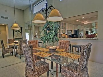 Dining Room & Kitchen with a view of the Golf Course.