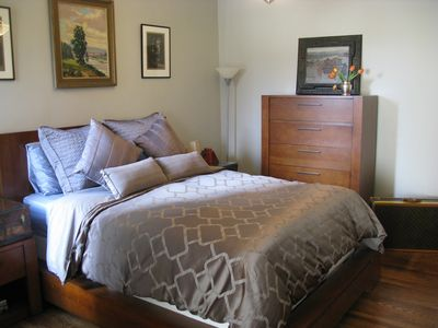 Second bedroom includes a queen size bed and original pocket doors.