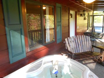 Relax by the Hot Tub, in the Glider/Rocker, facing the hills of The Smokies