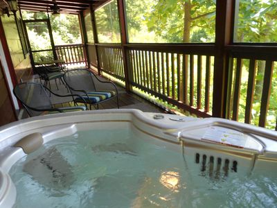 Hot Tub in the screened-in porch, with views of the hills of the Smoky Mountains