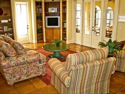 Sit a spell in the living room and get easy access to the screened in lanai!