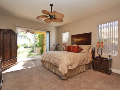 Master Suite with huge walk-in closet and doors opening onto private patio