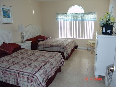 The 4th bedroom on first floor with 2 full size beds