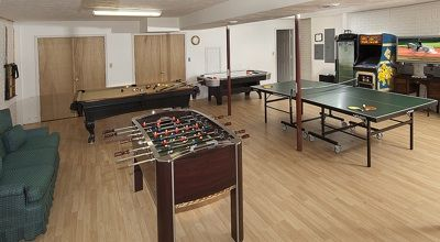 Game room with pool table, foosball, ping pong, air hockey and Ms. Pacman