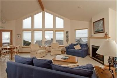 'Ocean Landing' Living Room with wall of windows overlooking ocean