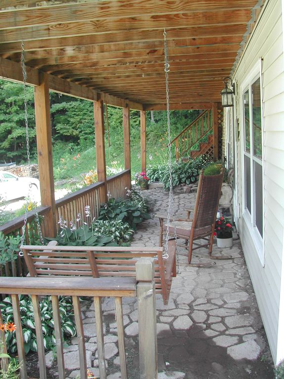 Porch swing and patio lower level.