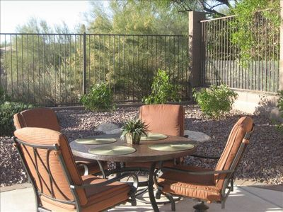 Quiet backyard and patio overlooking a natural desert wash.