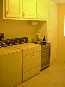 Laundry room with garage direct access. 60-bottle wine refrigerator & pantry