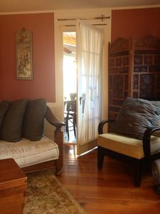 Downstairs parlor includes a spacious day bed and seating area for entertaining.