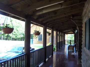 The Lodge main entrance and front porch / decking that extends around all sides