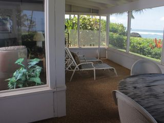 Haleiwa cottage photo - Screened in lanai, you have beautiful views and calming sounds of the ocean