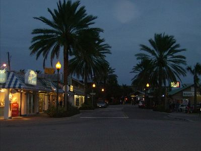 Stroll the shops on a warm tropical evening at John's pass.