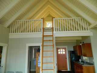 The 7' sleeping loft over the bathroom has a Queen bed. - Harpswell cottage vacation rental photo