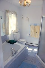 Avon-by-the-Sea house photo - Full bath with jacuzzi tub and shower off of queen bedroom on 3rd floor