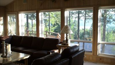 Large windows provide treetop views of WF Lake, mountain vistas, etc.