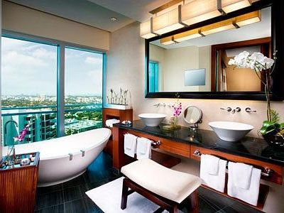 Bathroom with floor to ceiling windows, his & hers sinks, soaking tub, shower.