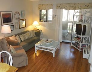 Port Royal villa photo - New wood floor enhances the comfort and beauty of the living & dining areas.