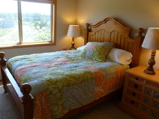 Bandon house photo - Third bedroom with queen bed - view of the Bandon Beach Riding Stables & meadow