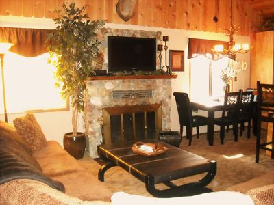 Open Concept Living Area with wood burning fireplace & flat screen TV - cable