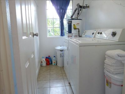 Laundry Room with Washer, Dryer and Cleaning Products, Hampers in every closet