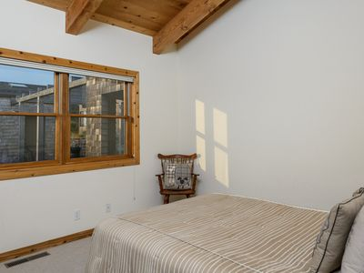 Second bedroom with queen bed and courtyard view