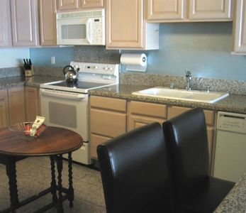 Open kitchen with all the conveniences & a complimentary snack basket.