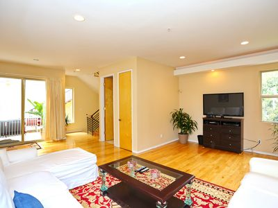 Living Room: Large 51 in. TV with all the premium channels. Patio in background