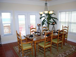 Gulf Shores house photo - Large dining table. Dining area opens to beachfront porch. Breakfast bar seats 4