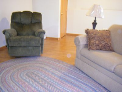 Rapid City house rental - Lower level living area with foldout couch