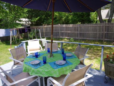 Relax on the deck while the kids and dog romp & play in safe, fenced back yard.