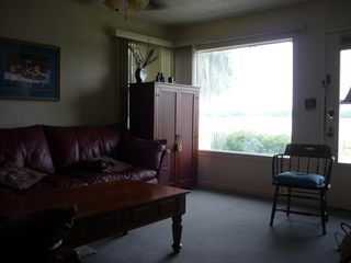 Crescent City cottage photo - Living room with view of Lake Stella