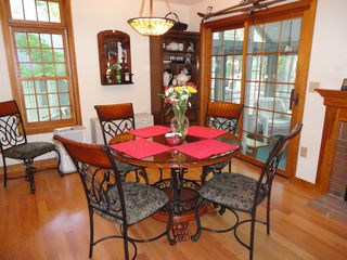 Laconia townhome photo - Dining area with sliders to Screened Porch