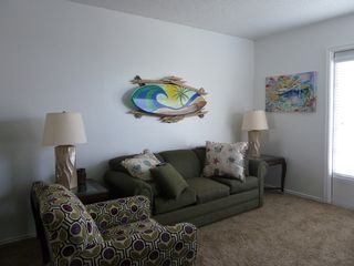 North Padre Island condo photo - Condo living area with 42 in. flat panel tv and queen size pull out sle...