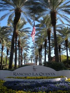 Giant palm trees adorn the entrance to Rancho La Quinta Country Club.