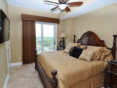 "Grandview East condo rental - Master Bedroom 2 king bed and balcony overlooking front beach rd with a 47"" TV"
