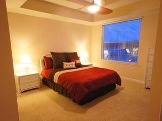 Osage Beach condo photo - 1 of 3 Queen Master Suites w/ Lake View, and access to the Screened-In Deck