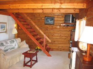 Addison cottage photo - Living area with steps to loft-