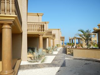 Cayman Brac townhome photo - .Walk down the sidewalk to the ocean.