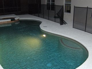 Aviana Resort house photo - Pool at night w/ safety fence! Lanai with Table, Chairs and 3 Loungers...