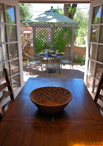 Santa Fe house rental - View from Dining Room through French Doors onto the Patio with Dining Area